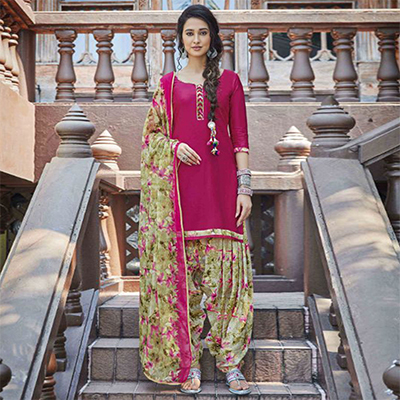 Flamboyant Pink Colored Casual Wear Printed Heavy Cotton Patiala Dress Material