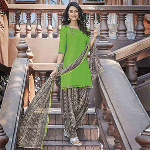 Lavishing Green Colored Casual Wear Printed Heavy Cotton Patiyala Dress Material