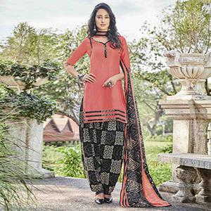 Dazzling Peach Colored Casual Wear Printed Heavy Cotton Patiyala Dress Material