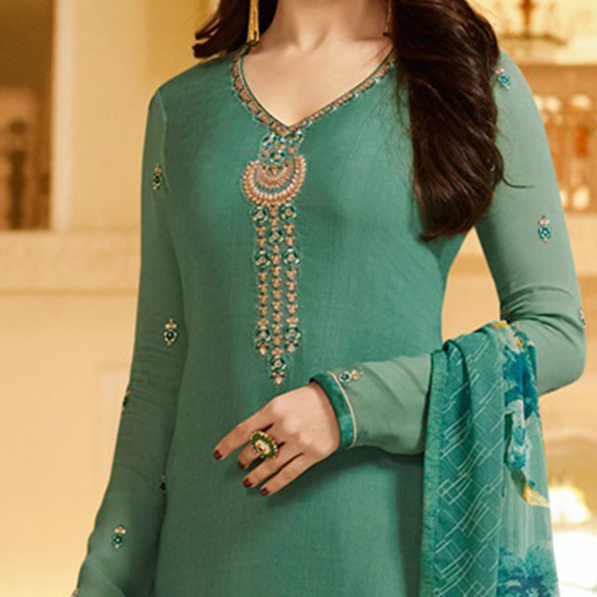 Attractive Green Embroidered Party Wear Royal Crape Salwar Suit