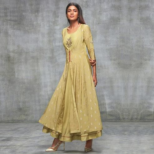 Prominent Cream Colored Partywear Embroidered Cotton Silk Kurti