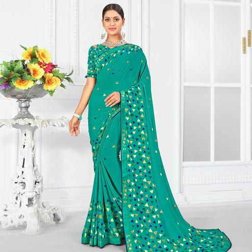 Pretty Turquoise Blue Colored Partywear Foil Work Georgette Saree