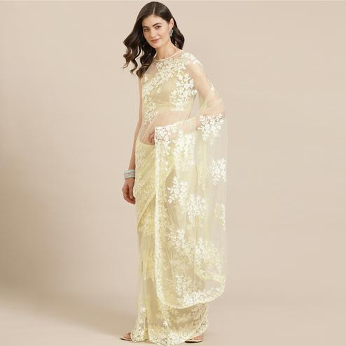 Demanding Light Yellow Coloured Partywear Floral Embroidered Net Saree