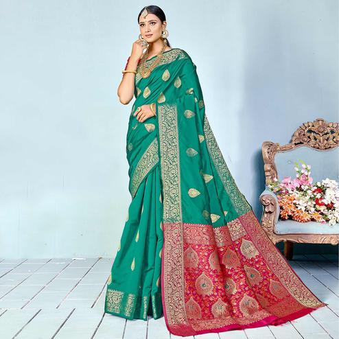 Dazzling Turquoise Green Colored Festive Wear Woven Silk Saree