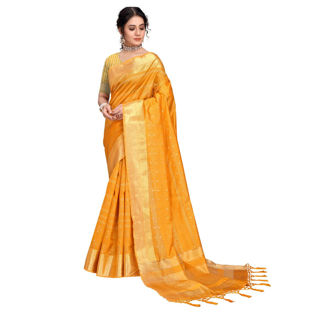 Attractive Mustard Colored Assam Silk Foil Printed Saree With Tassels