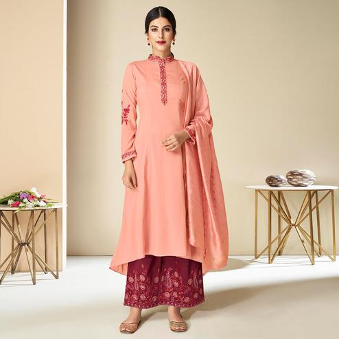 Captivating Peach Colored Partywear Embroidered Pure Muslin Silk Palazzo Suit With Dupatta