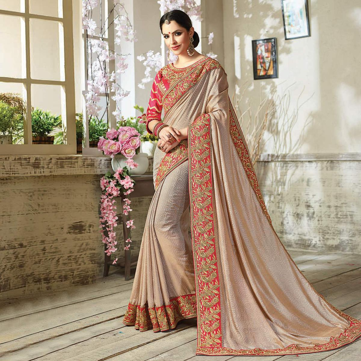 Graceful Beige Embroidered Partywear Moss Georgette Saree