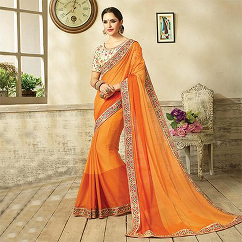 Marvellous Shaded Orange Embroidered Partywear Moss Georgette Saree