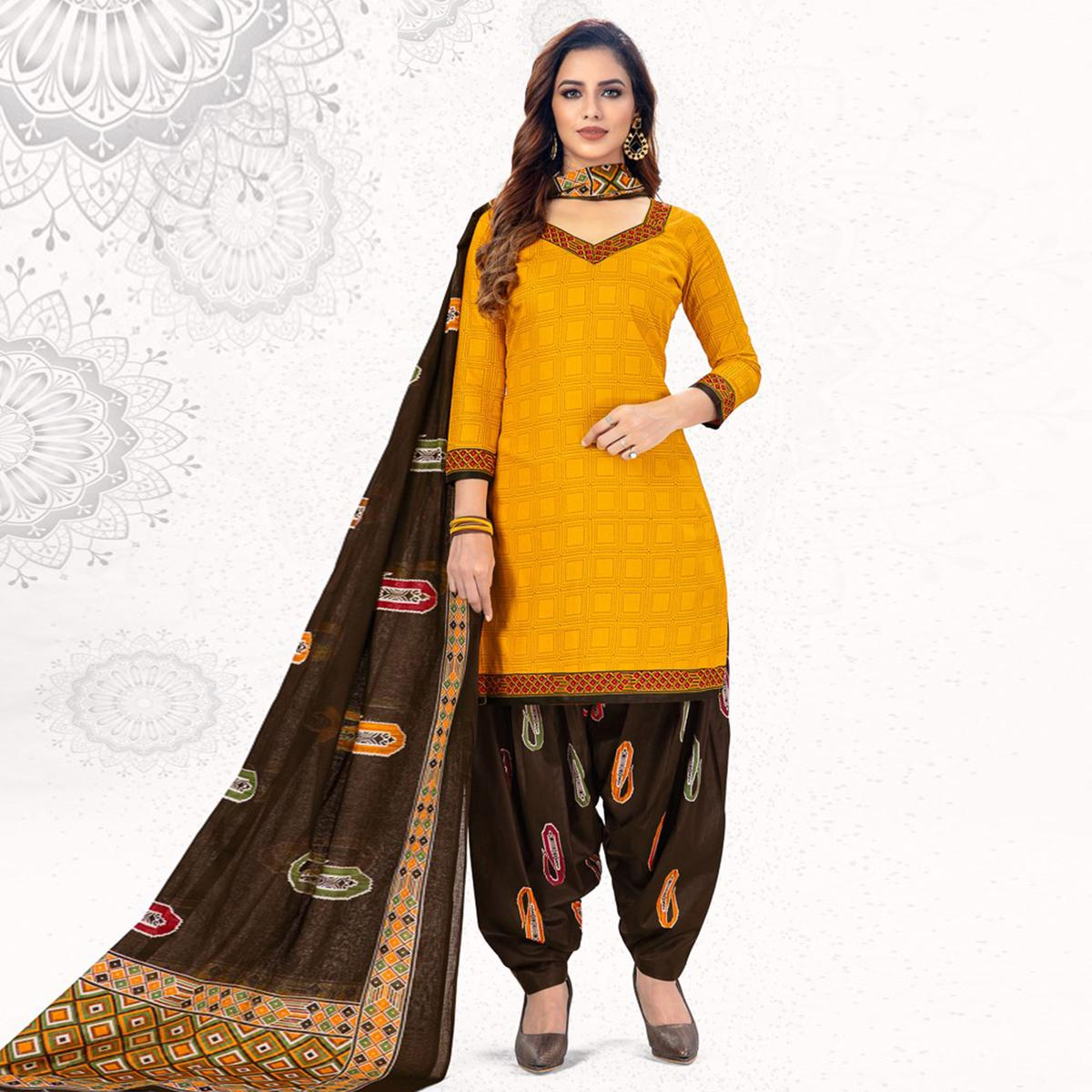 Magnetic Yellow Colored Casual Wear Printed Pure Cotton Patiala Dress Material