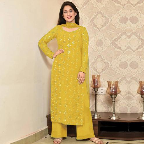 Ideal Yellow Colored Partywear Mirror Work Cotton Dress Material