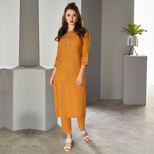 Blooming Mustard Yellow Colored Partywear Embroidered Pure Viscose Kurti With Pant