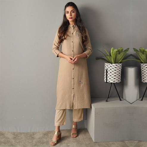 Engrossing Beige Colored Partywear Embroidered Pure Viscose Kurti With Pant