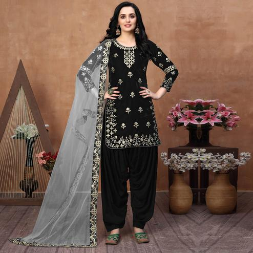 Trendy Black Coloured Partywear Mirror Embroidered Velvet Patiala Suit