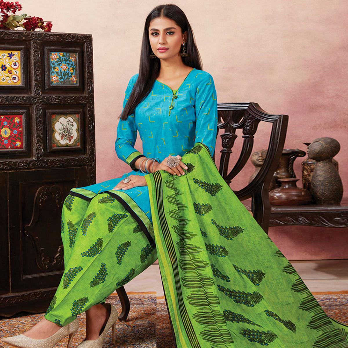 Dazzling Sky Blue Colored Casual Wear Printed Pure Cotton Patiala Dress Material