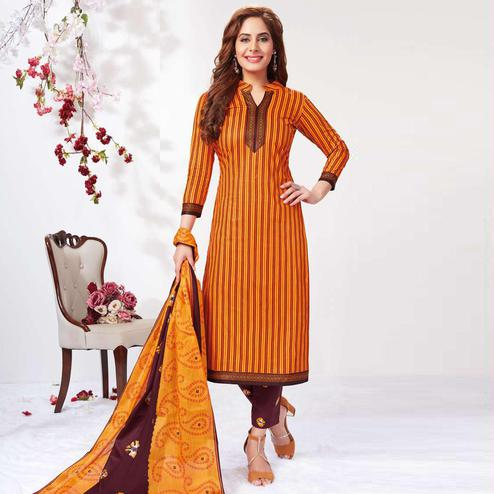 Energetic Mustard Yellow Colored Casual Wear Printed Pure Cotton Dress Material