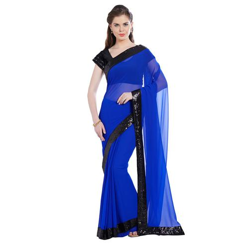 Adorable Blue Colored Partywear Georgette Saree With Matching Blouse.