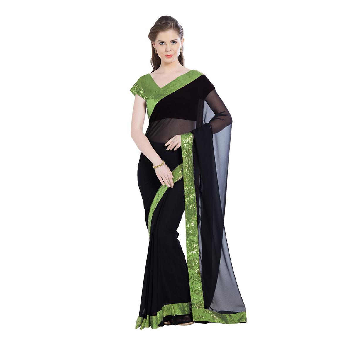 Demanding Black Colored Party Wear Georgette Saree With Matching Blouse.