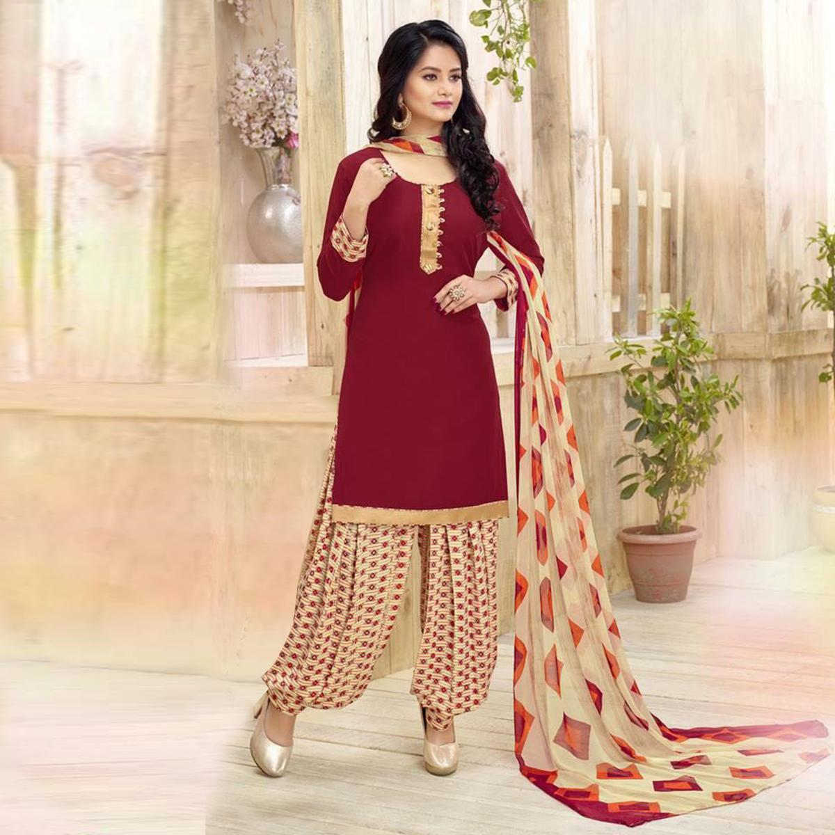 Stunning Maroon Colored Casual Wear Printed Heavy Crape Patiyala Dress Material
