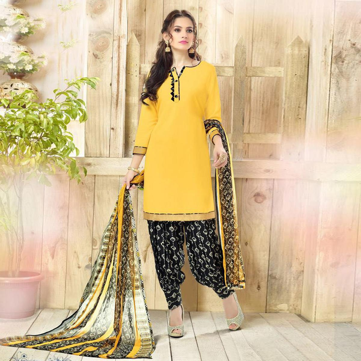 Lovely Yellow Colored Casual Wear Printed Heavy Crepe Patiala Dress Material