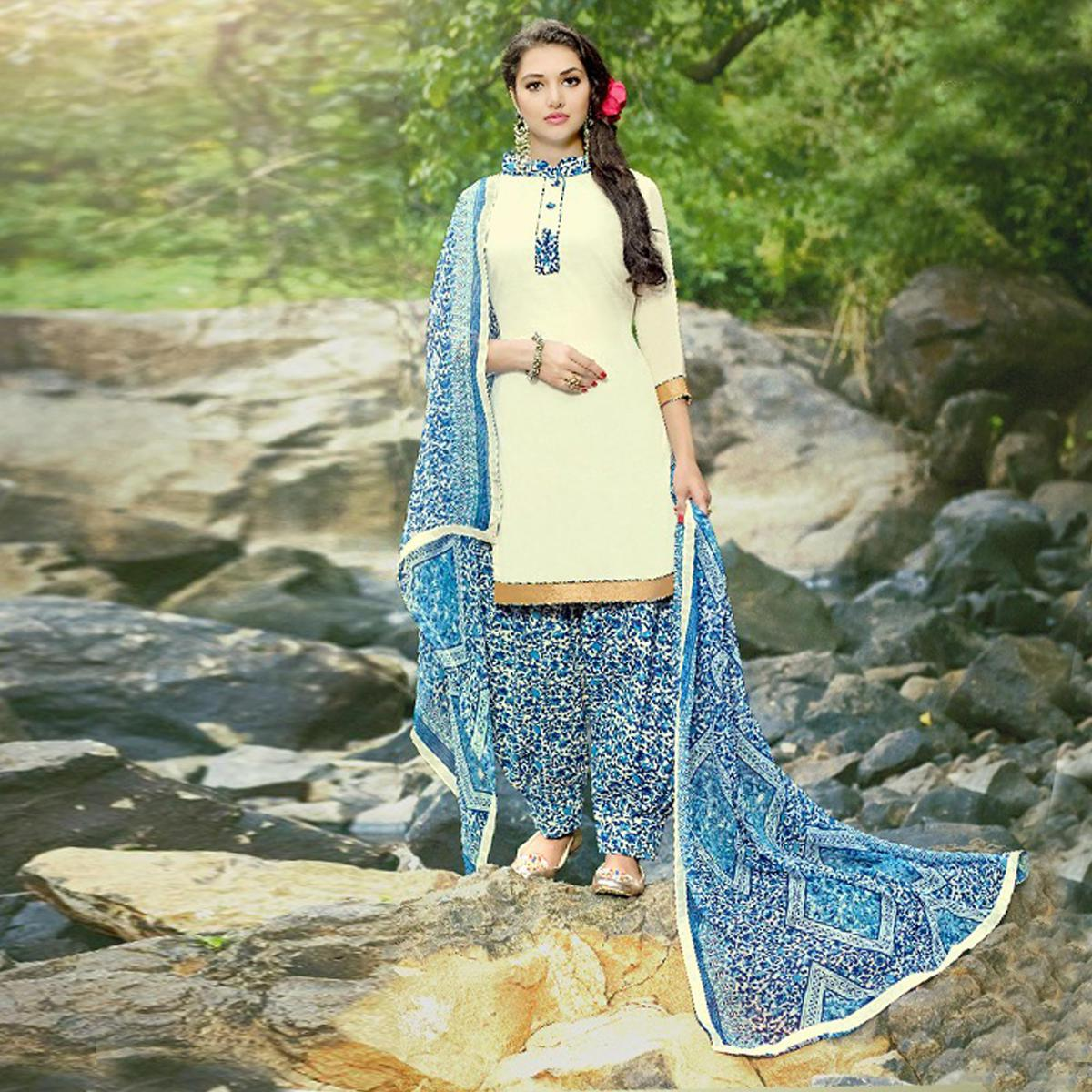 Graceful Cream-Blue Colored Casual Wear Printed Heavy Cotton Patiala Dress Material