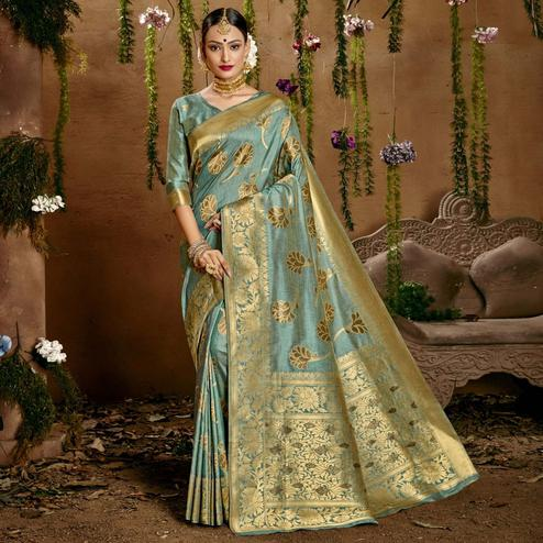 Triveni Turquoise Colored Cotton Jacquard Saree With Blouse Piece