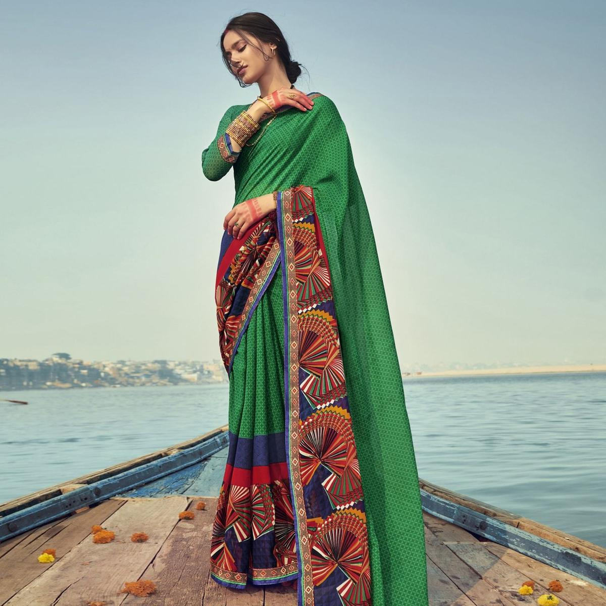 Triveni Dark Greeen Colored Georgette Printed Saree With Blouse Piece