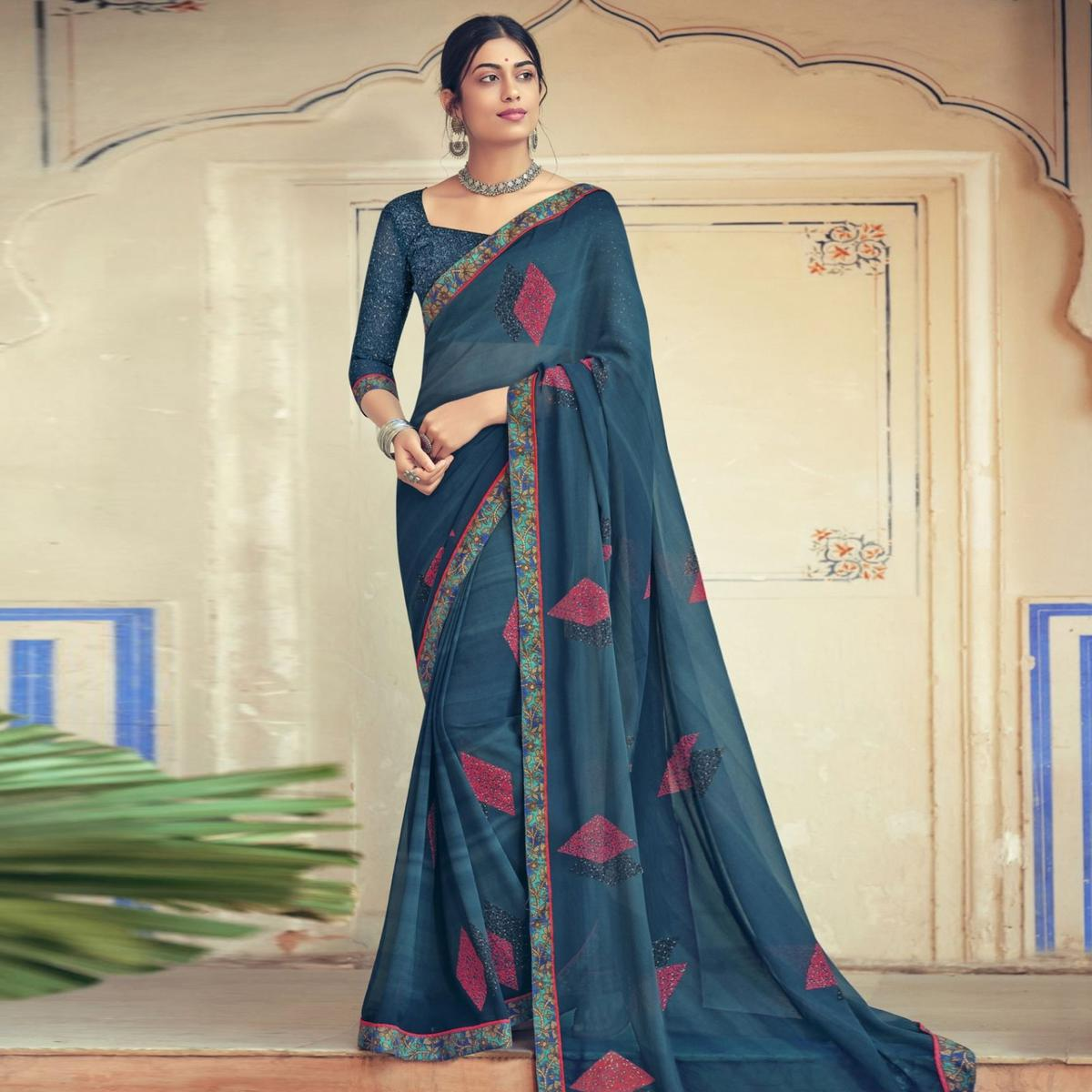 Triveni Turquoise Colored Georgette Printed Saree With Blouse Piece