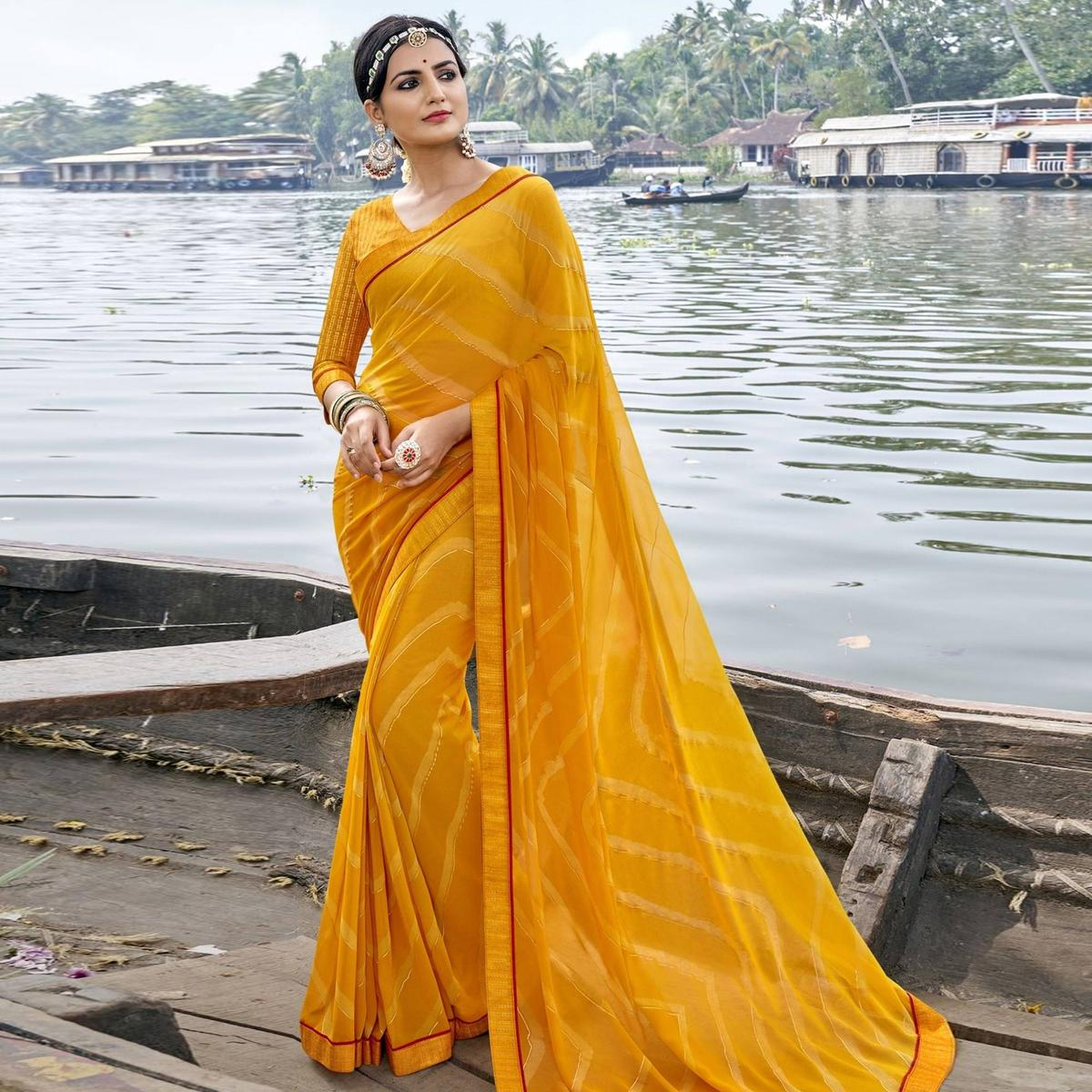 Triveni Yellow Colored Georgette Foil Printed Saree With Blouse Piece