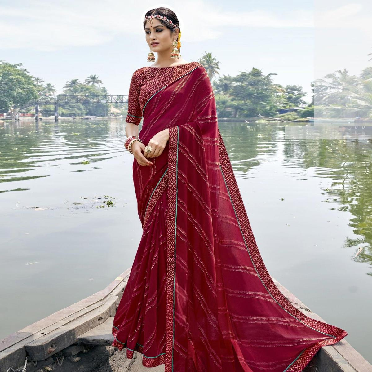 Triveni Maroon Colored Georgette Foil Printed Saree With Blouse Piece