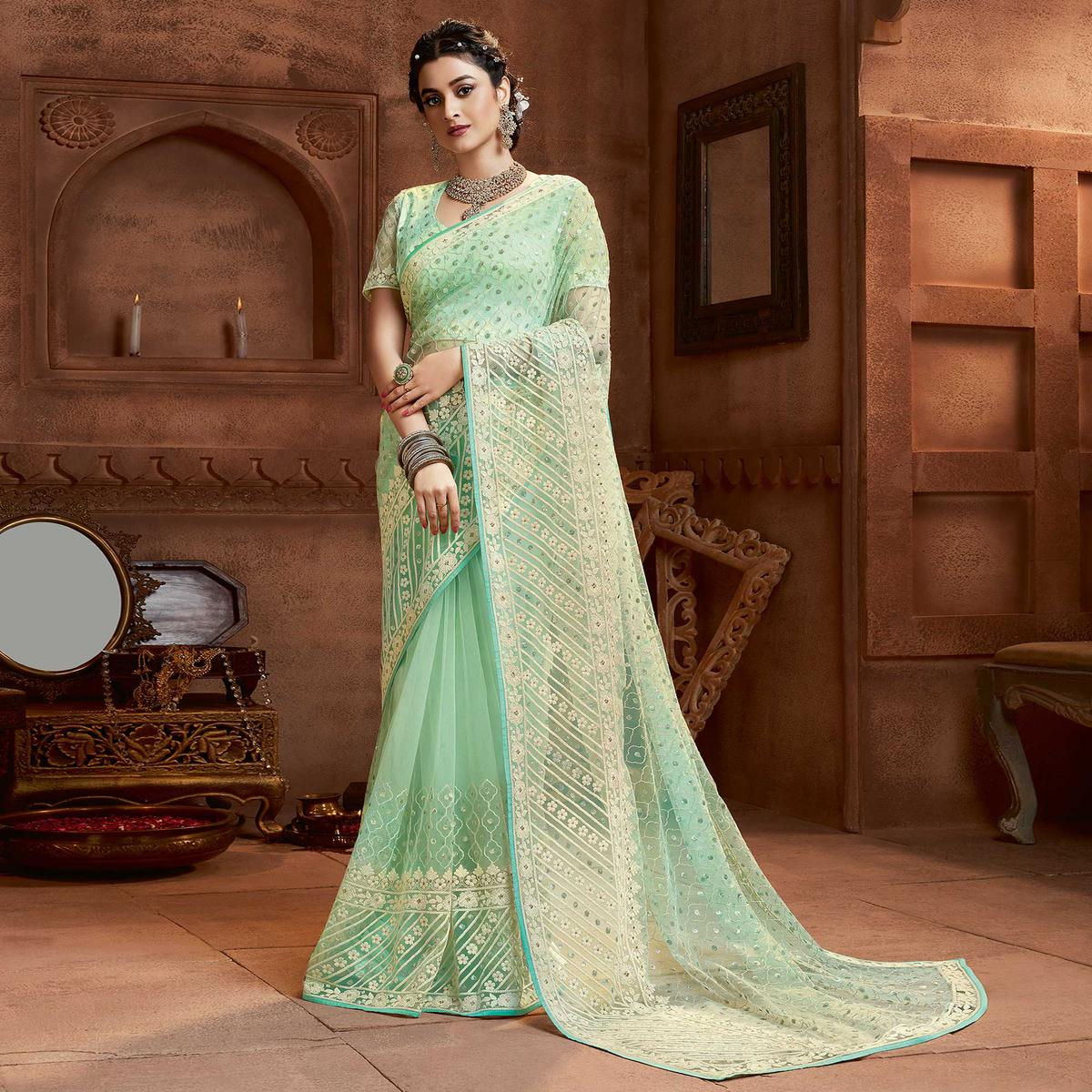 Prominent Mint Green Coloured Partywear Embroidered Soft Net Saree